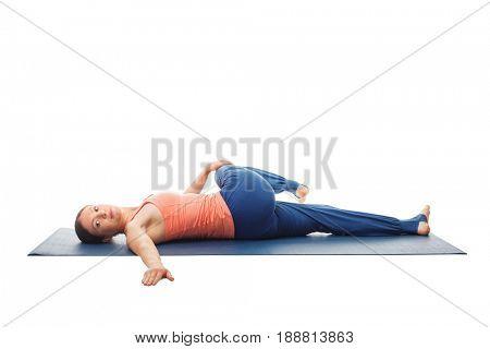 Woman doing Yoga asana Parivrtta ardha pawanmuktasana - Revolved knee-to-chest Pose. Stretches back isolated on white background