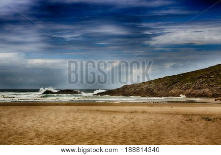 Ocean coast in the north west of Spain, Galicia region, surfers famous wild beach of Soesto