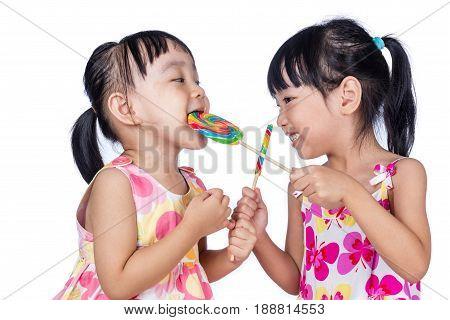 Asian Little Chinese Girls Eating Lollipop