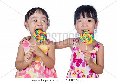 Asian Little Chinese Girls Eating Lollipop