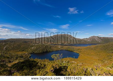 High angle view of Lake Lilla and Dove Lake surrounded by green mountains at Cradle mountain, Lake St Clair National Park. Autumn in Tasmania, Australia
