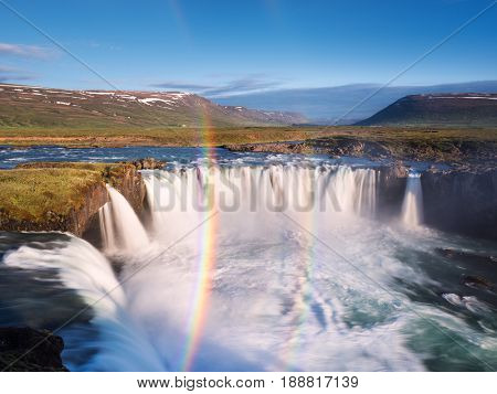 Godafoss waterfall and rainbow. Beautiful summer landscape in Iceland, Europe. World beauty