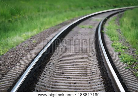 View of the railway tracks. Beautiful turn and perspective. Industrial background for design