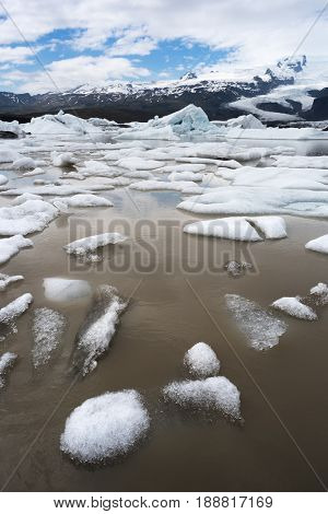 Day landscape with ice floes in the glacial lake Fjallsarlon. Vatnajokull National Park, Iceland, Europe. Amazing tourist attraction
