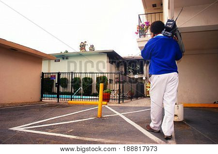 SACRAMENTO, CALIFORNIA, USA - August 28, 2010: TV cameraman shoots an apartment destroyed by fire that also critically injured a young child.
