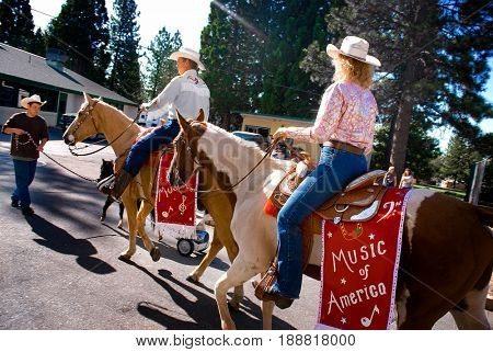 WEST POINT, CALIFORNIA, USA - October 3, 2009: Horses and riders representing Music of America walking through a parking lot before a Lumberjack Day parade