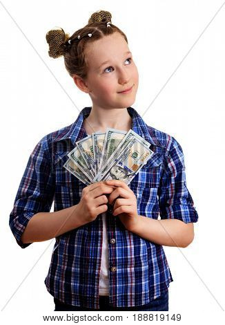 Cute little kid girl in chekered shirt holding the US dollars and looking on something above, isolated on white background. Pocket money concept.