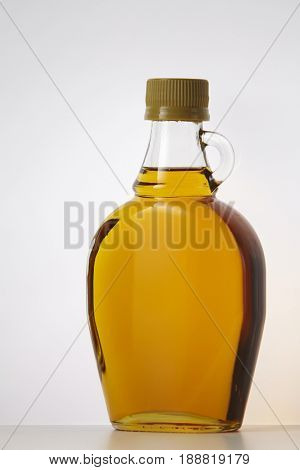 golden agave syrup on the white background