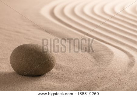 spa wellnes relaxing background with stone in raked sand