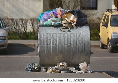 Dumpster being full with garbage