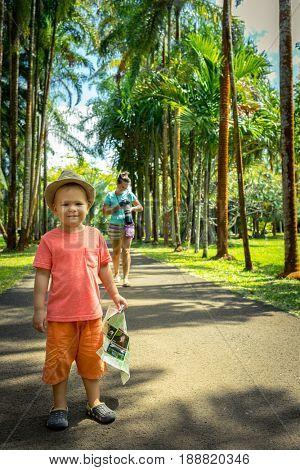 Mother and son at botanical garden. Mauritius