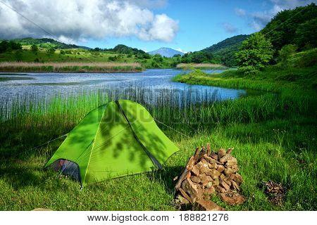 green tent on Biviere Lake in Nebrodi Park, Sicily