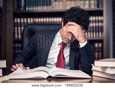 Businessman reading a book in his office