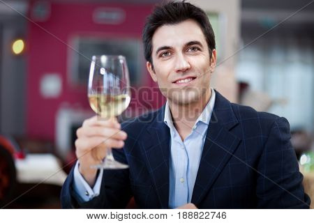 Man tasting wine in a restaurant