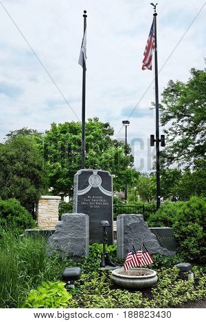 NAPERVILLE, ILLINOIS - MAY 26, 2017: War Memorial at Veterans Plaza in the Naperville Riverwalk. The Riverwalk follows the West Branch of the DuPage River.