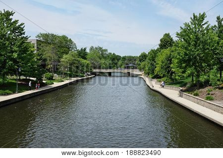 NAPERVILLE, ILLINOIS - MAY 26, 2017: Riverwalk along the West Branch of the DuPage River through Naperville, Illinois.
