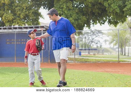Hispanic coach and young baseball player