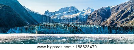 Glacier Bay Alaska banner view from cruise at Johns Hopkins Glacier summer travel in Alaska, USA. Banner panorama crop.