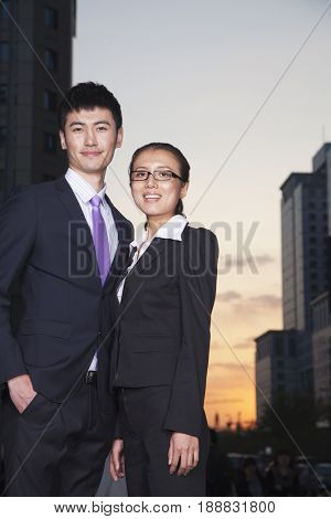 Chinese business people standing outdoors