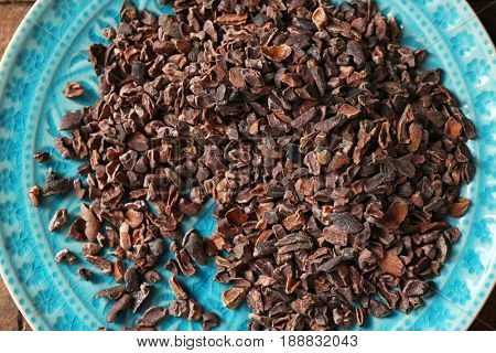 Plate with cocoa nibs, closeup