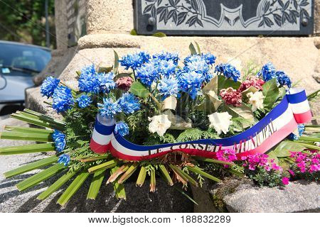 Flower arrangement with ribbon from Municipality