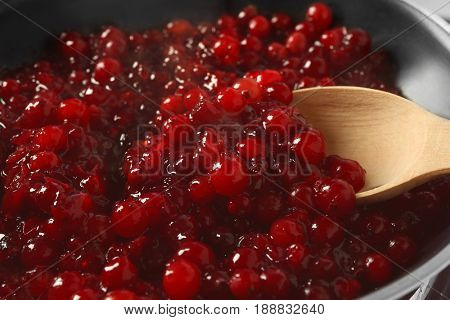 Delicious cranberry sauce in pan close up