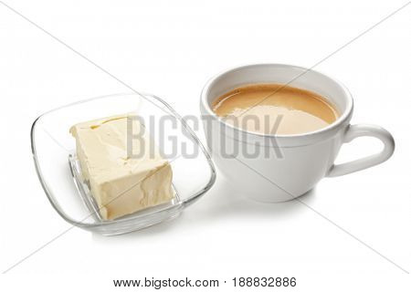 Composition with tasty butter coffee on white background