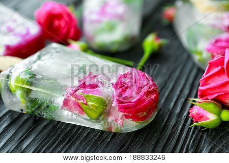 Homemade ice pop with flowers on wooden background