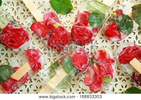 Homemade ice pops with flowers on tray