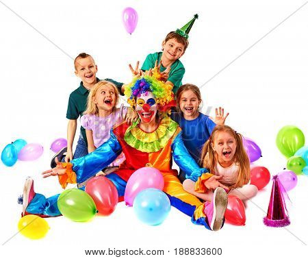 Birthday child clown playing with children. Kid holiday cakes celebratory in hands of events organizer man. Fun of group people lying floor on white background. Happy childhood.