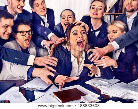 Mad business people office. Team people are unhappy with their leader. Intern woman manager does not cope with his duties. Crazy crowd in stress throw up their chief's papers