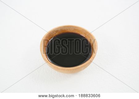 Close-up of soy sauce bowl on white background