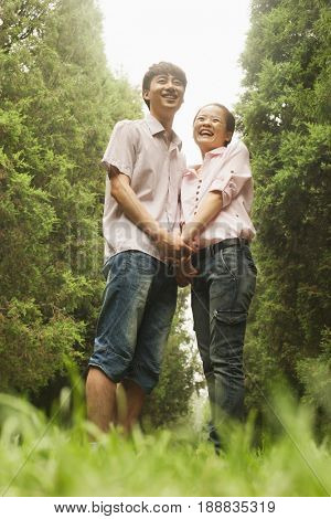 Chinese couple standing in park