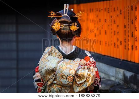 KYOTO, JAPAN - NOVEMBER 11, 2016: Woman wearing traditional japanese kimono walk on the street of Gion, Kyoto old town, Japan. Kimono is a Japanese traditional garment.