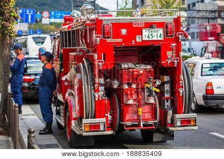 KYOTO, JAPAN - NOVEMBER 11, 2016: Japanese Fire Department car on the street of Kyoto in Japan. Kyoto Metropolis is one of the most populous city of Japan.