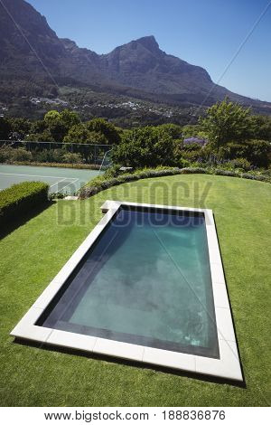 Modern and luxurious swimming pool in lawn