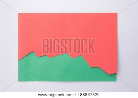 Picture of red business graphic isolated over green background.