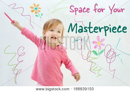 Art concept. Cute little girl standing near white wall with space for design