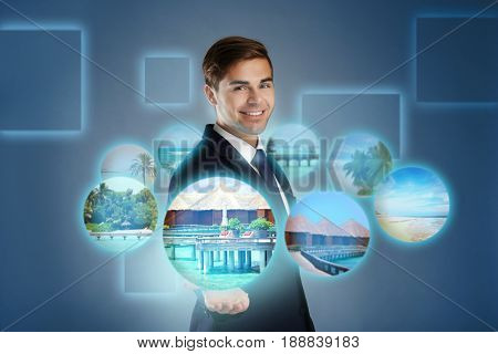Man demonstrating variants of tours on virtual screen. Travel agency concept