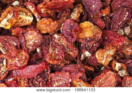 Dried Sicilian tomatoes closeup. Red tomatoes. Village market organic tomato