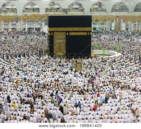 Kaaba in Makkah with crowd of Muslim people all over the world praying together