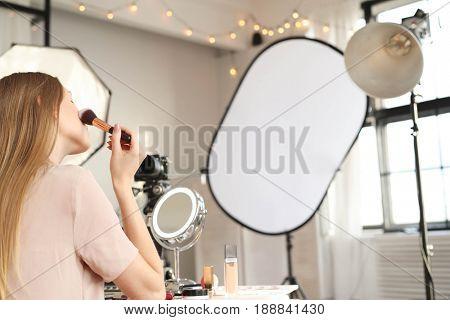 Make-up. Beauty blogger at work