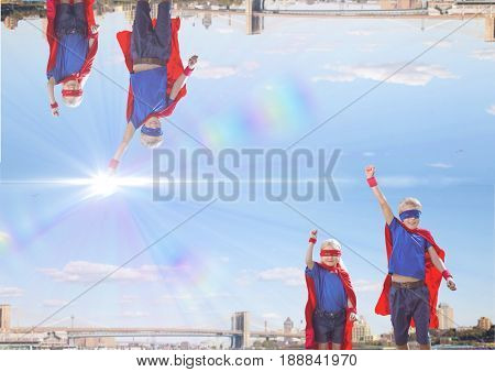 Digital composite of up side down city with light in the middle of the sky. super hero children