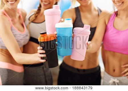 Young women group resting at the gym after workout