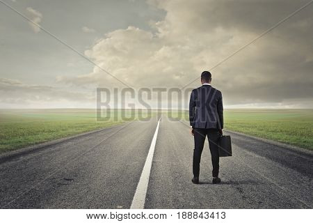 Businessman on a long solitary road