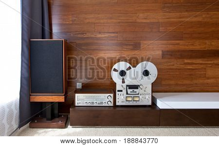 Vintage audio system in minimalistic modern interior, frontal view