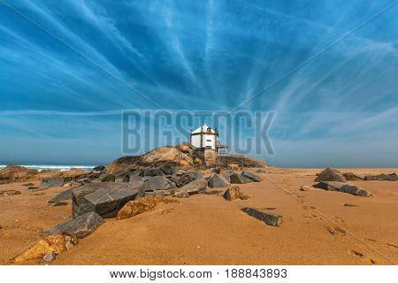 Chapel Senhor da Pedra at Miramar Beach, Atlantic ocean near Porto, Portugal.