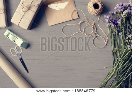 Statis Flowers Arrangement with Present Gift Box Copy Space