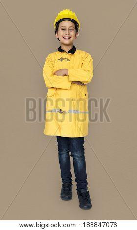 Little Boy in Fireman Costume Studio Portrait