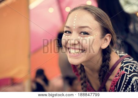 Woman painting face for party hanging out